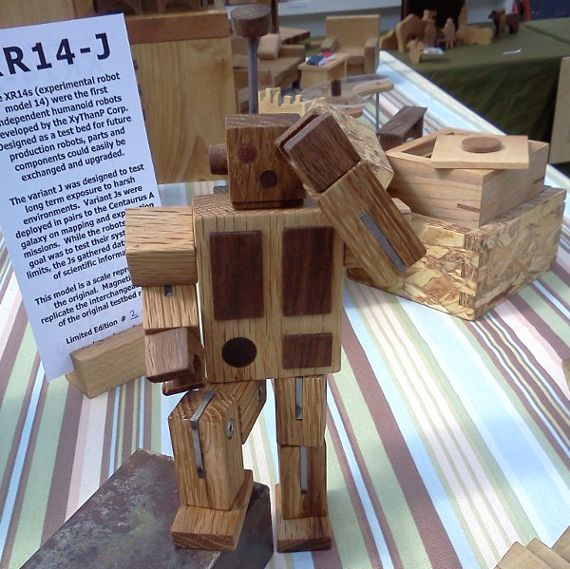 tired wood robot toy after long day of work
