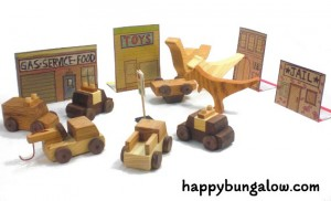 wood dinosaurs cause havok with wooden toy cars in play scene