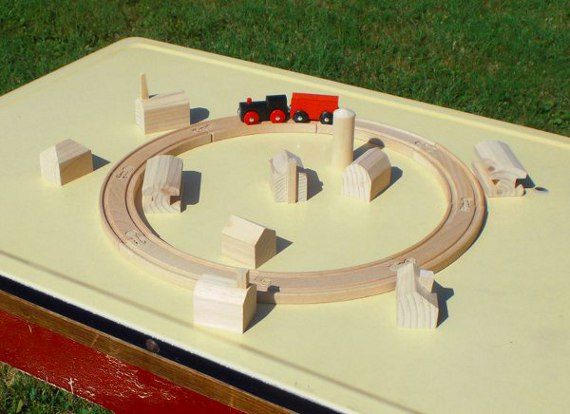 toy railroad track and buildings