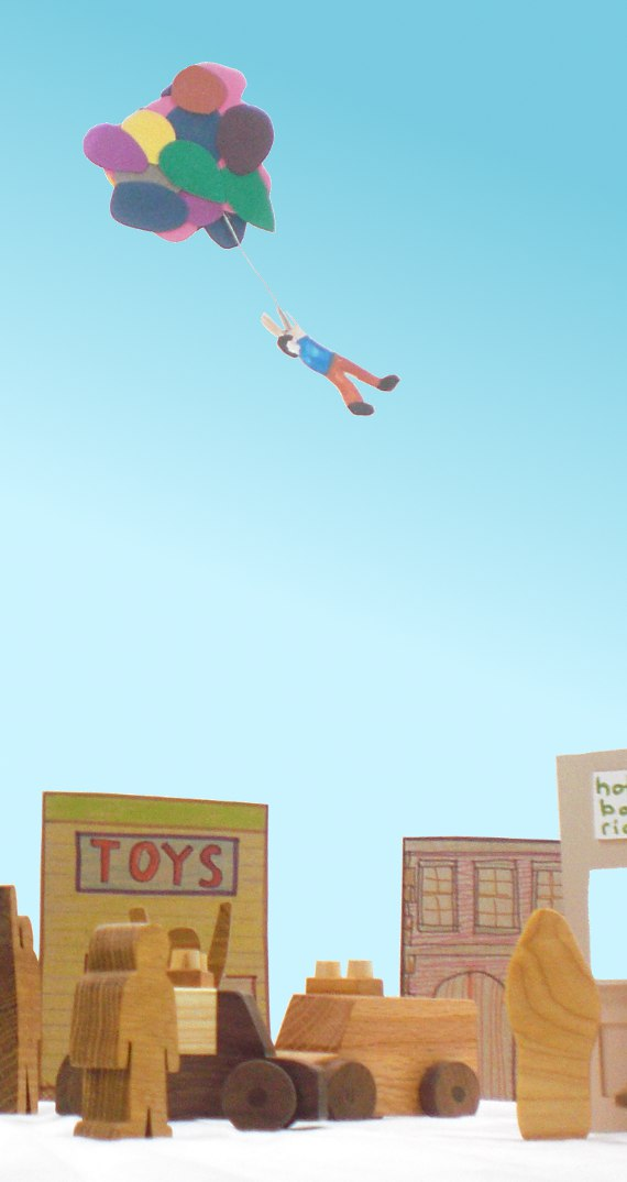 toys pose for fanciful story of boy flying into air