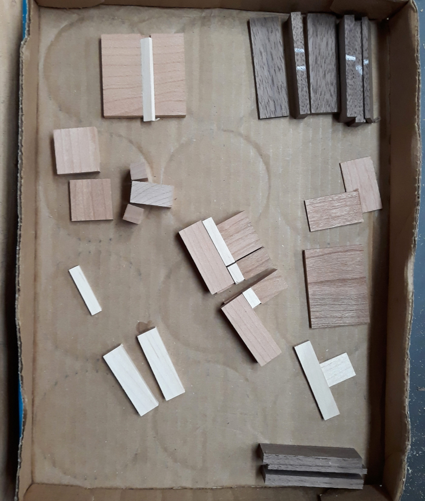 Small wood pieces ready for gluing